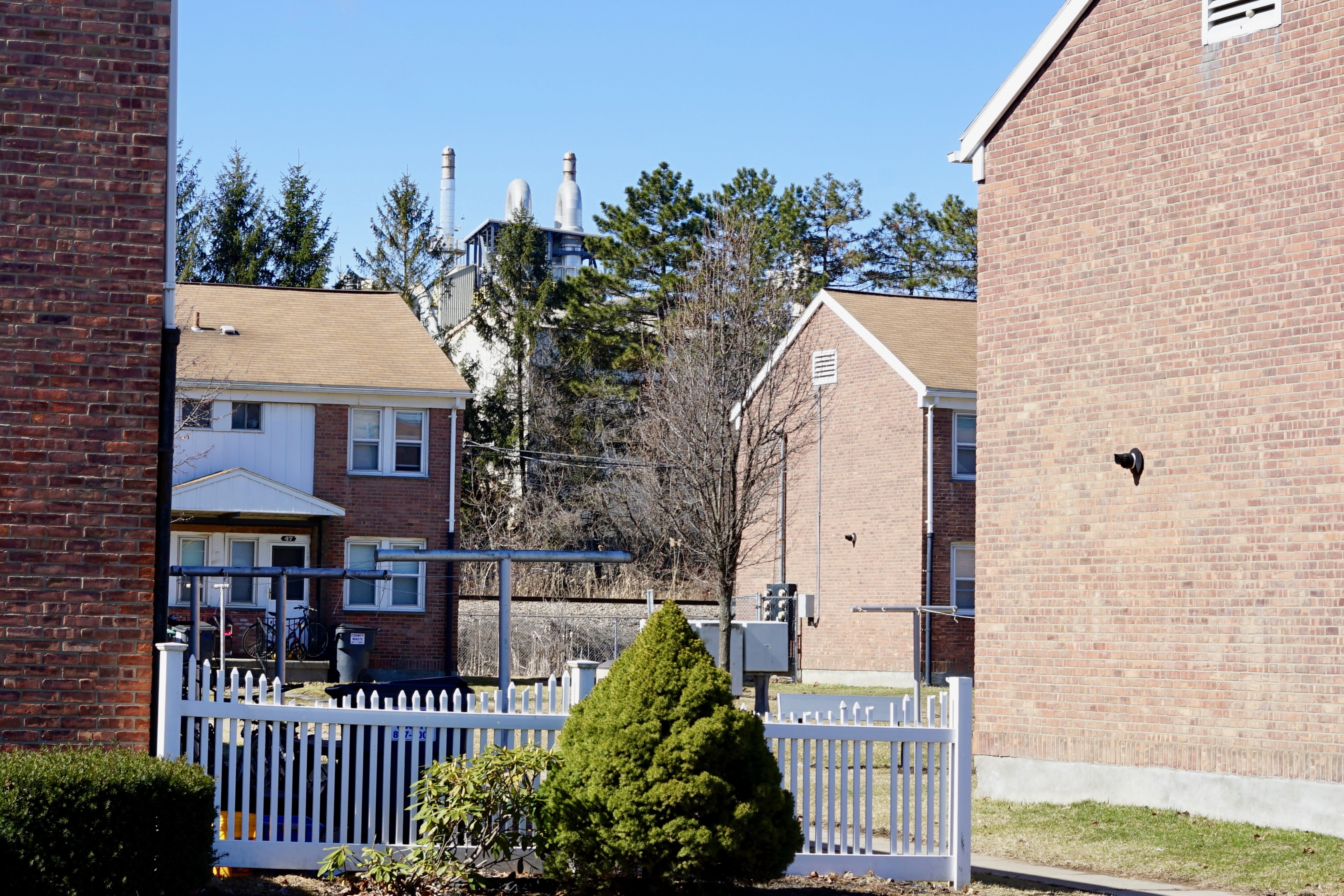 Caption: Norlite hazardous waste incinerator looms over Saratoga Public Housing Complex in Cohoes, NY (photo by David Bond)