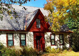 frost farmhouse exterior in fall