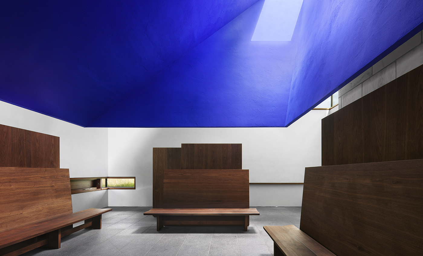 meditation space in capa with blue ceiling and wooden benches
