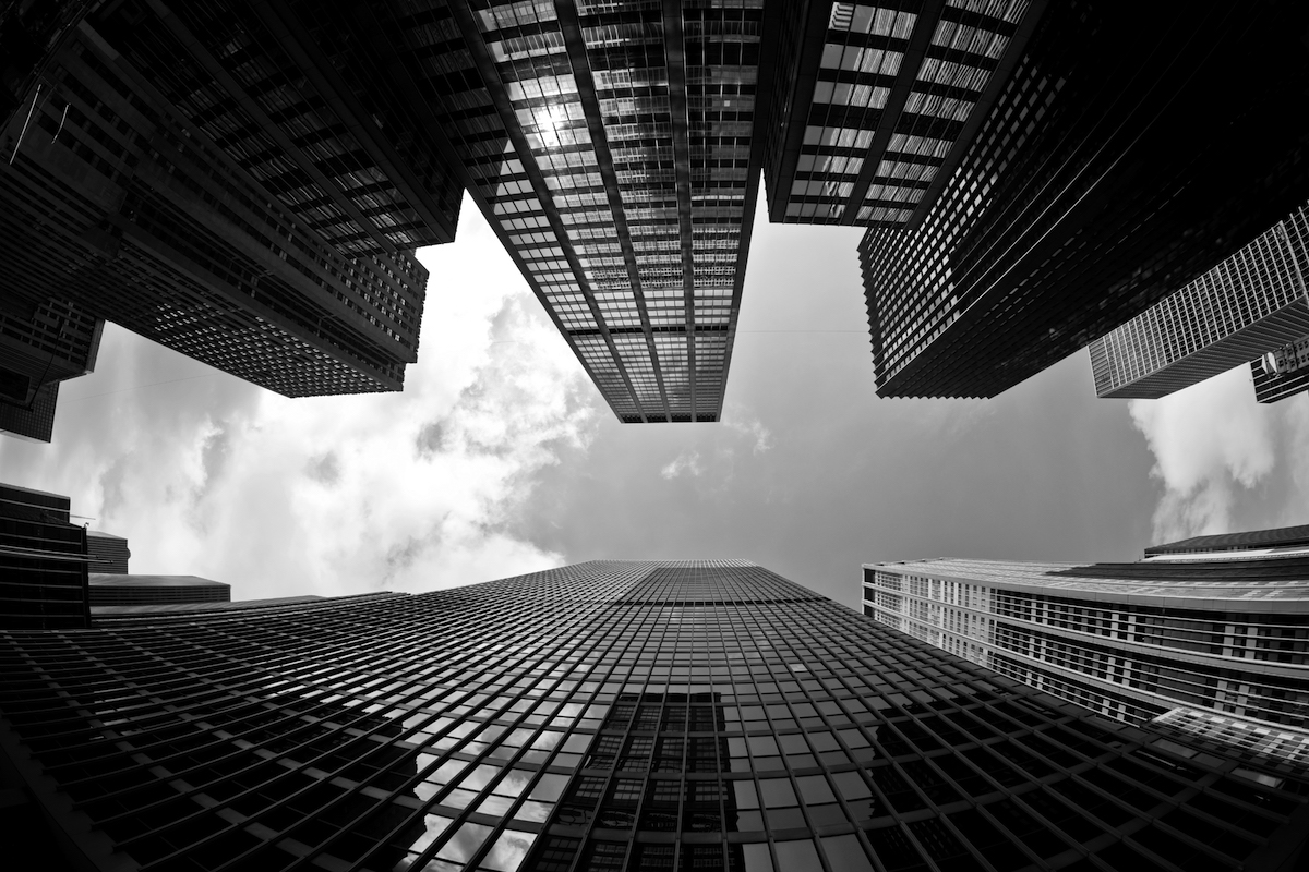 skyscrapers viewed from below in black and white