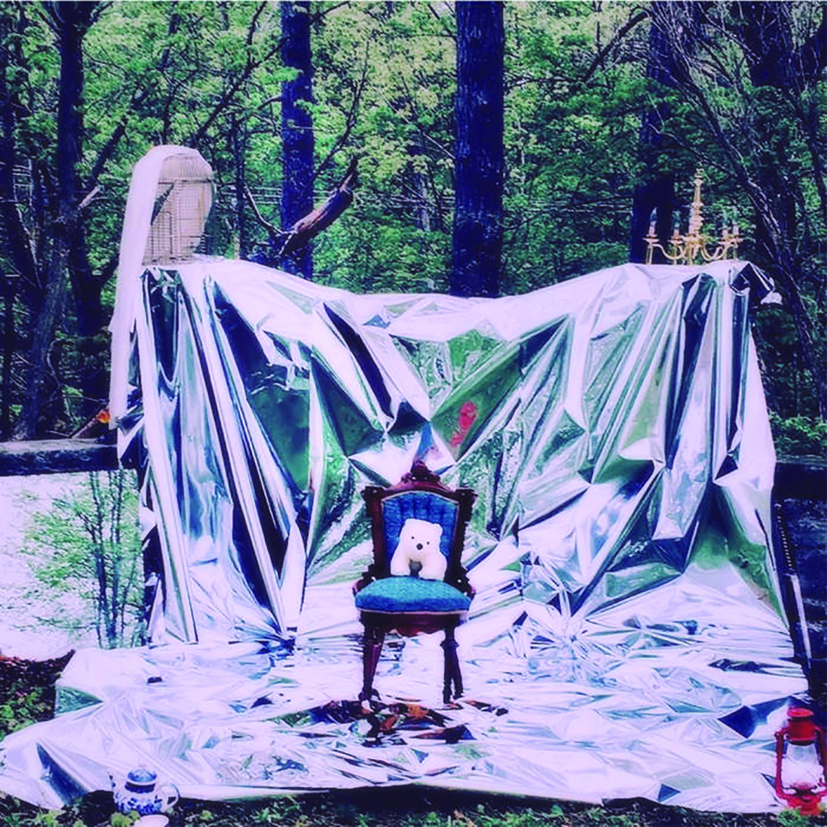 chair in a forest with shiny draped backdrop