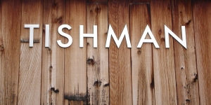 Tishman sign on wood