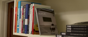 "image description: a shelf full of books on making careers in different fields. the front book reads, ""THE ART LIFE."""