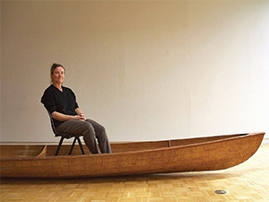 Photo of artist Marie Lorenz sitting in boat