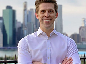 Image of Matthew Clarke in front of cityscape