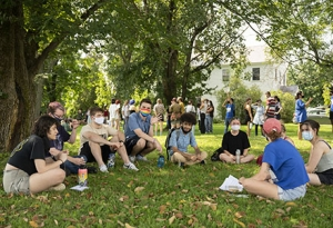 Image of students sitting in circle