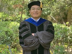 Image of man in PHD regalia