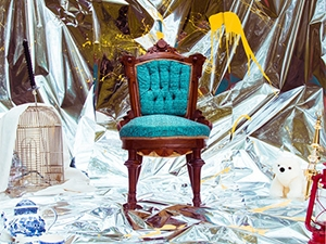 Album cover with chair on mylar backdrop