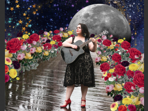Diana Alvarez playing guitar in space with flowers