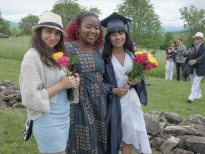 graduating students hold flowers