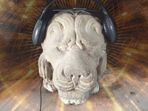 lion head made of stone wearing headsets