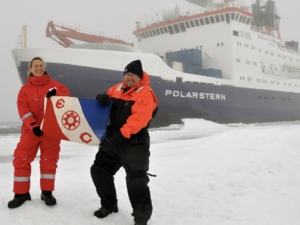 chris german and colleague in snowy landscape in front of a ship