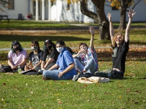 masked students on the lawn