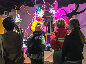 Photo of students looking at art installation