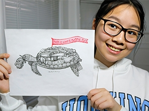 Photo of girl holding turtle poster