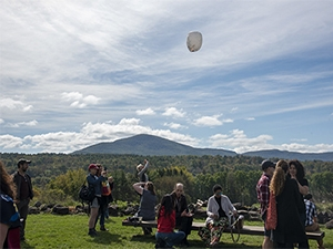Photo of mountains and floating lantern