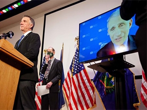 Image of Fauci and Phil Scott at press briefing