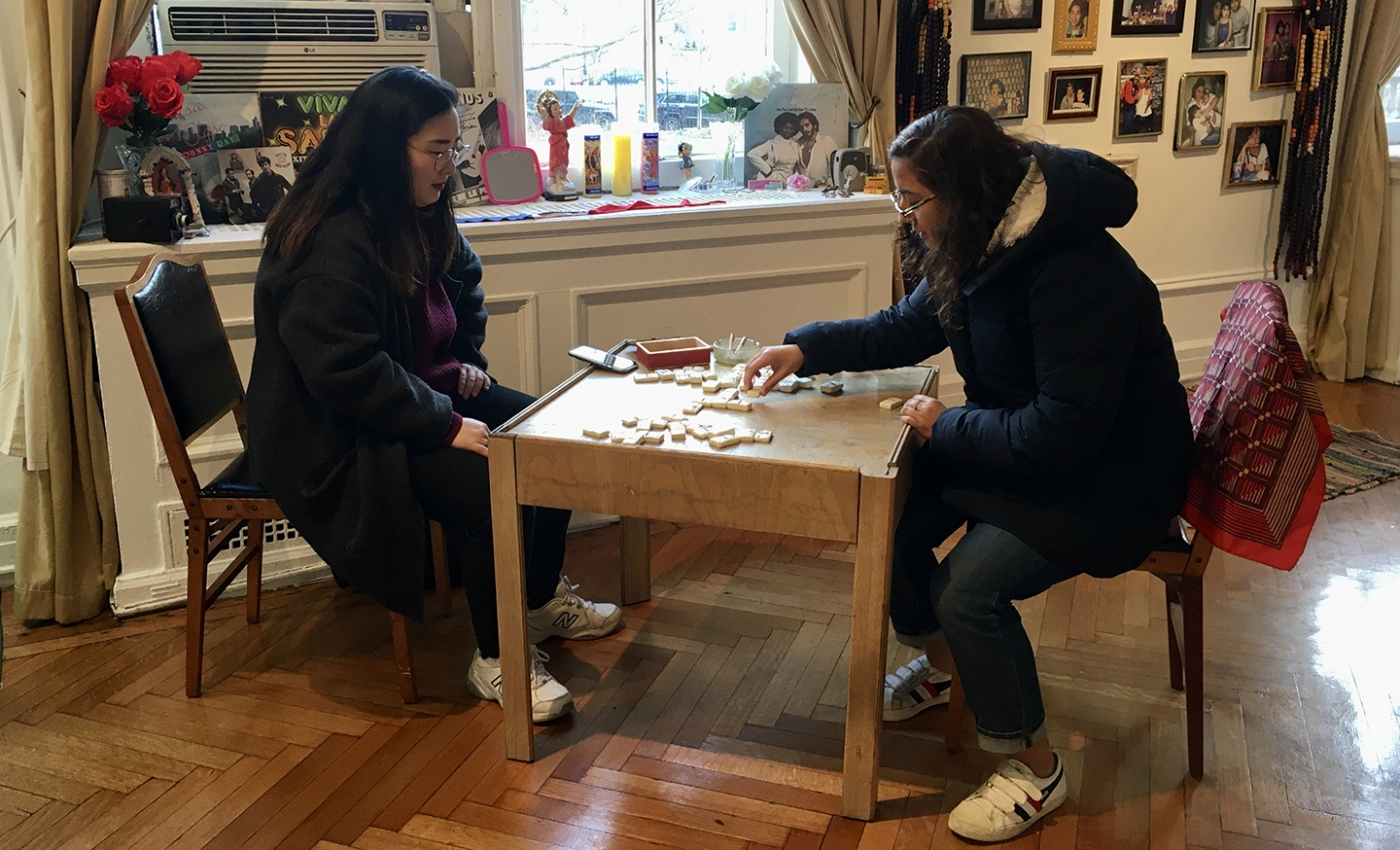 Students playing dominoes at exhibition