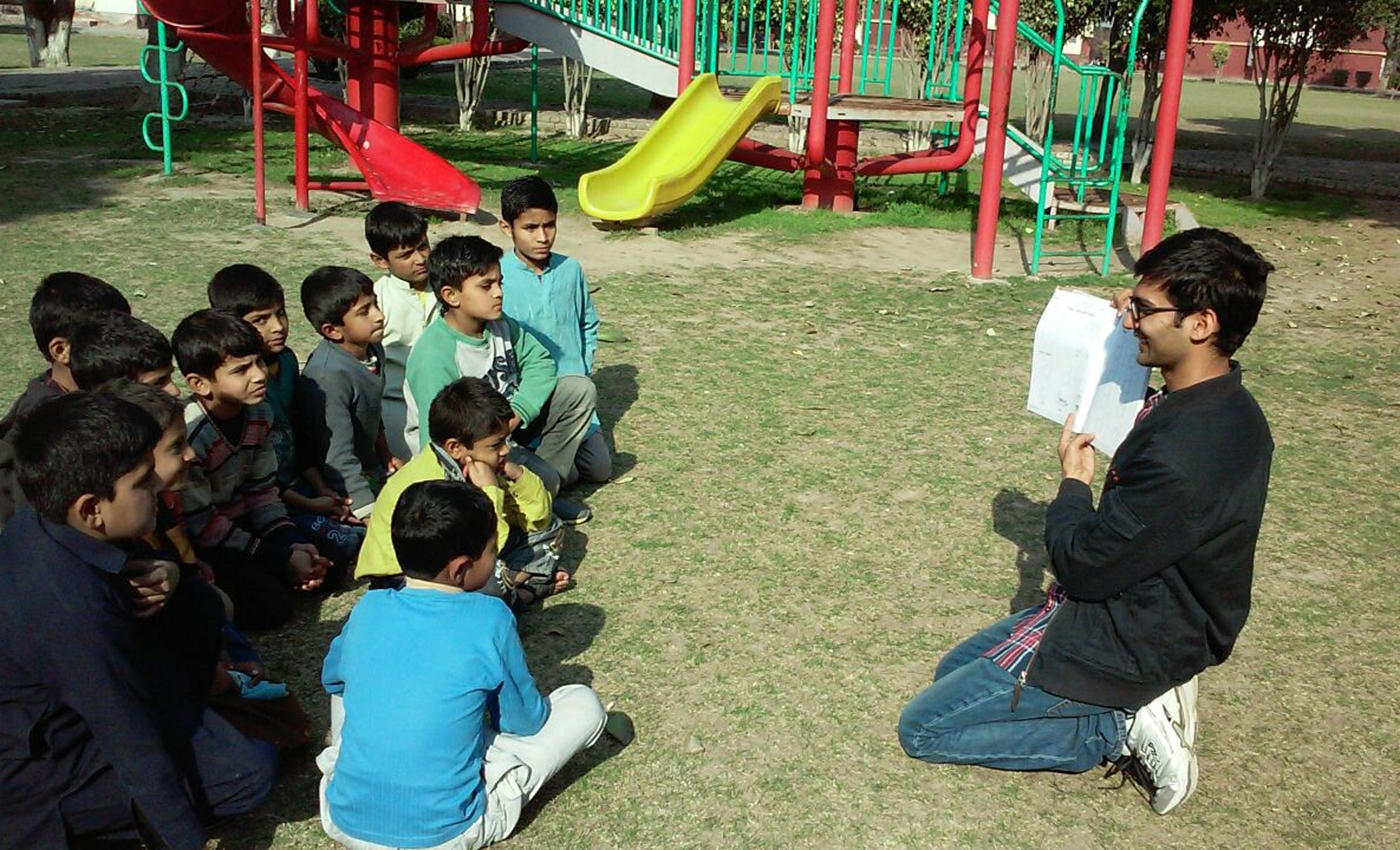 Muhammad Haroun teaching students during field work term