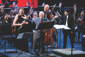 allen shawn in front of orchestra