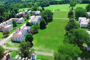 aerial shot of campus green lawn and trees