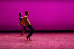 pink room, pink floor, pink wall, two dancers bending backwards