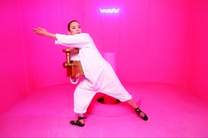 dancer in white in a very pink room