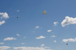 lanterns floating in a clear blue sky