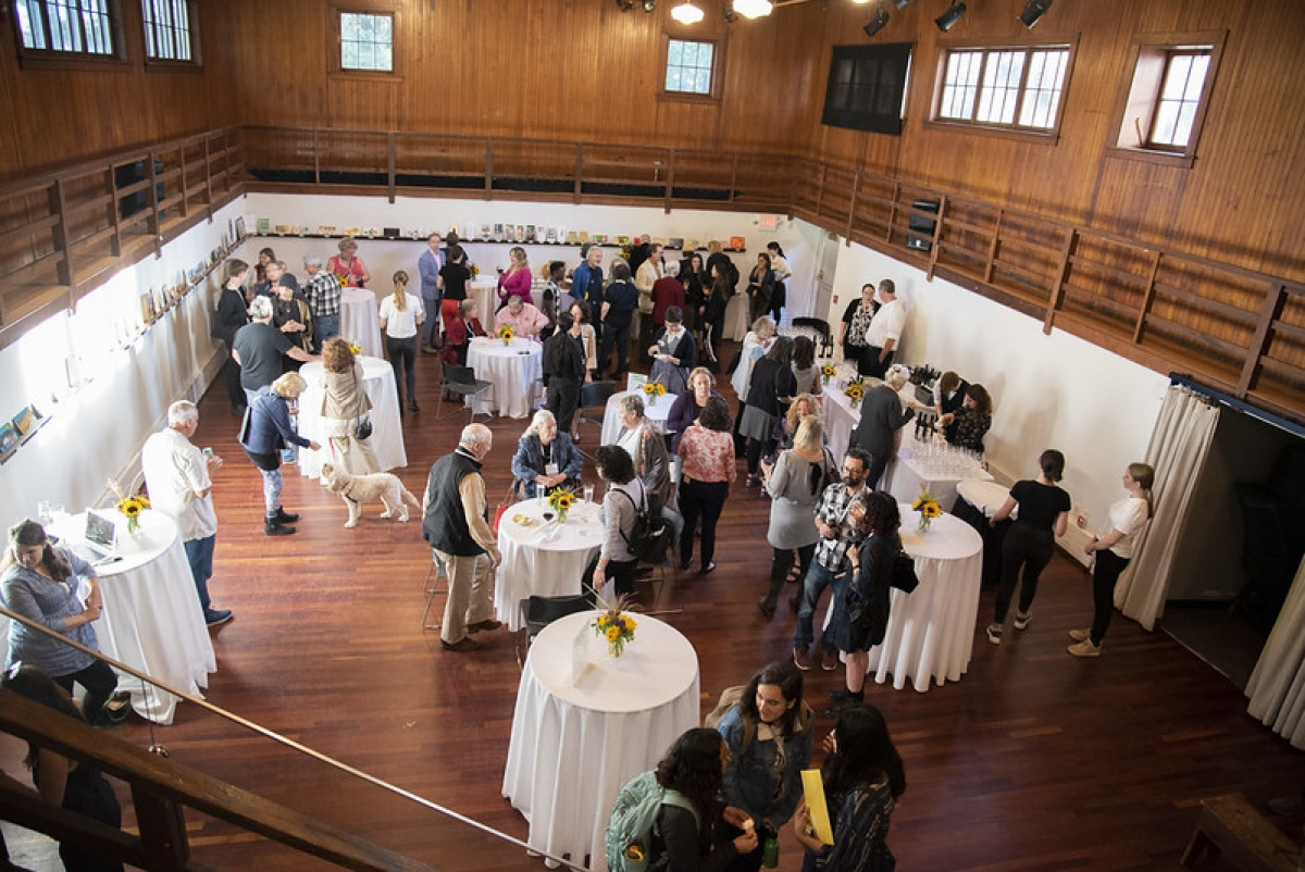 Alumni gathering in Deane Carriage Barn during 2019 reunion