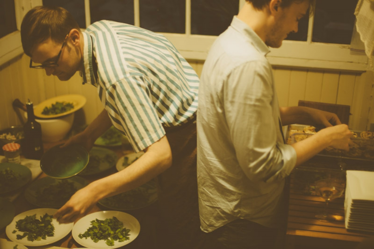 Andrew Barton and Lucas plating food