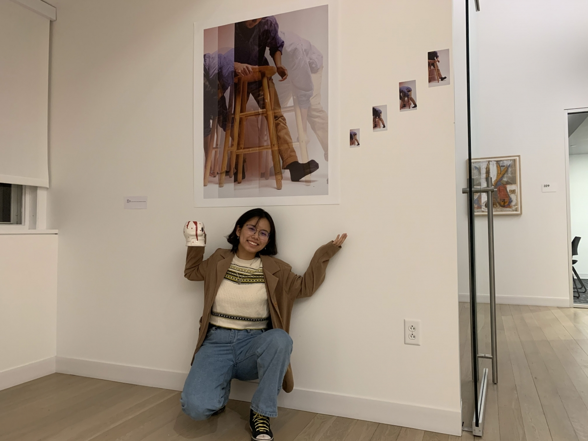 Photo of woman posing by photograph