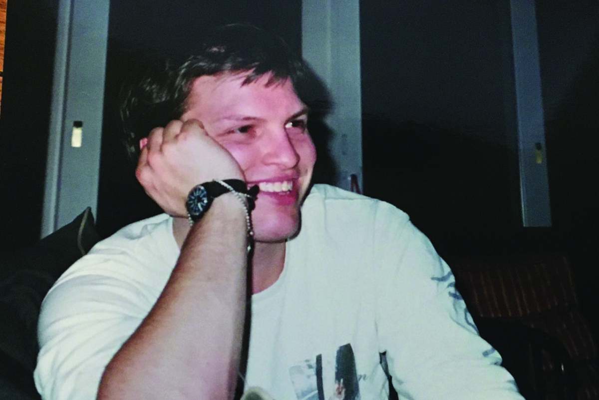 Matt Vohr, 1994, young man smiles at camera wearing a white teeshirt