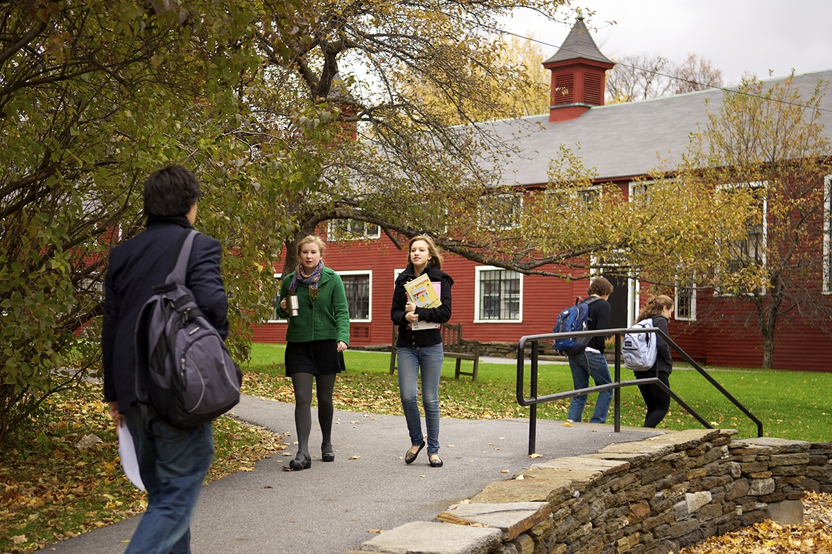 students walking to class in the barn