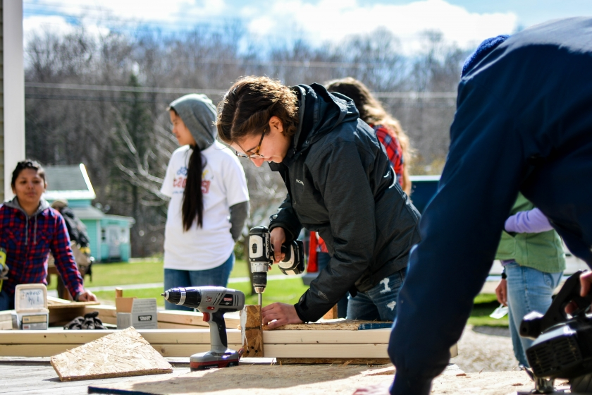 Picture of student participating in habitat for humanity