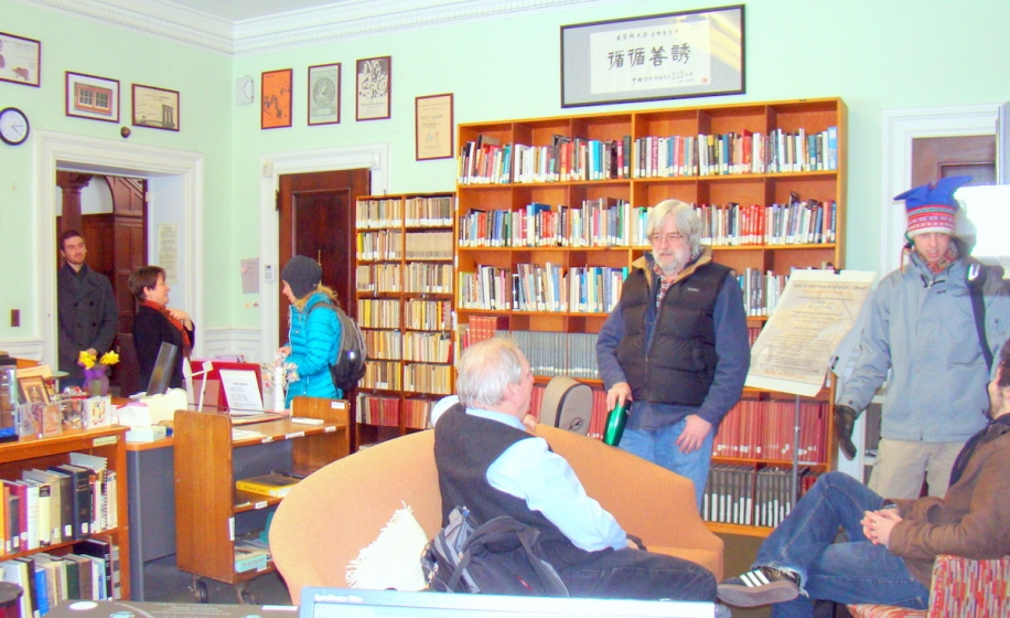a group of visitors in the music library